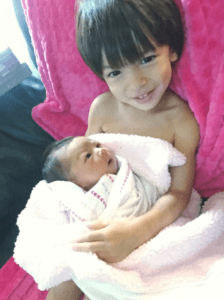 Paxton holding his sissy, Mila